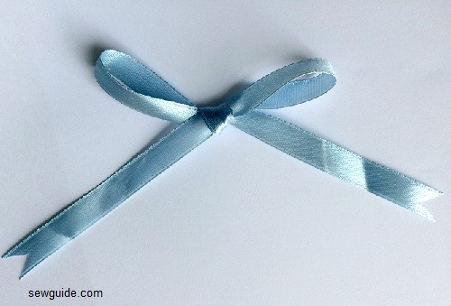 make a big bow out of ribbon