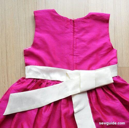 tie a sash bow in a dress