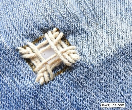 fix hole in jeans with embroidery