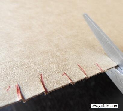 make a cardboard loom for handweaving fabric