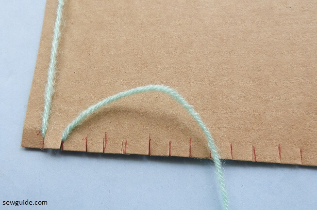 handweaving fabric with cardboard loom