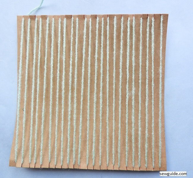 handweaving fabric with DIY cardboard loom