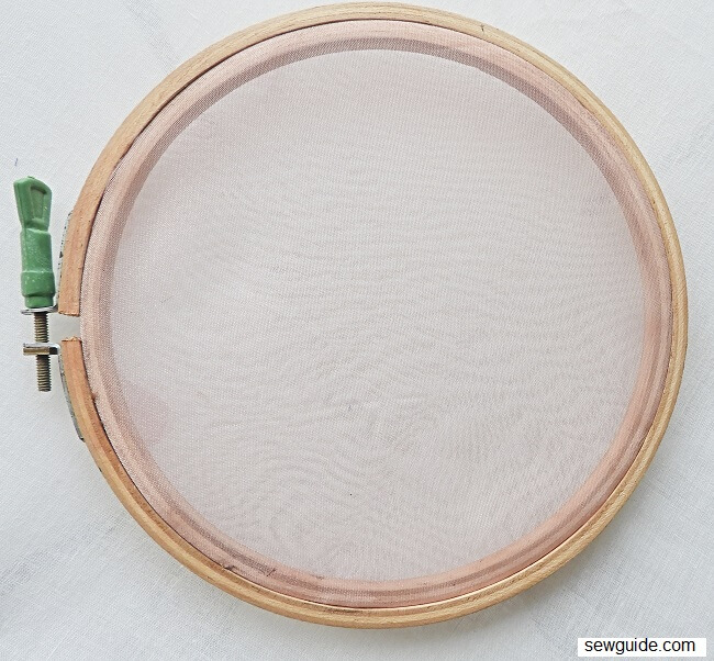 Hoops, frames and other methods to stretch fabric for embroidery