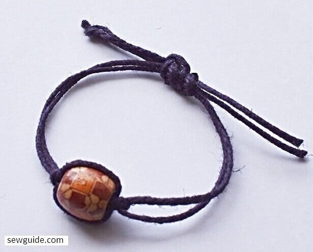 make bracelet with adjustable knot. 133