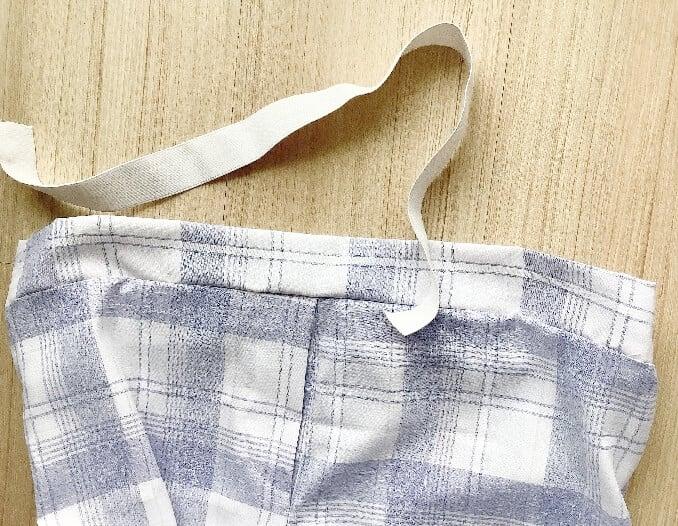 elastic- inserted-into pajama-pants-waistband