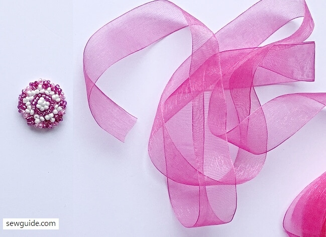 making rosettes with beads and ribbon